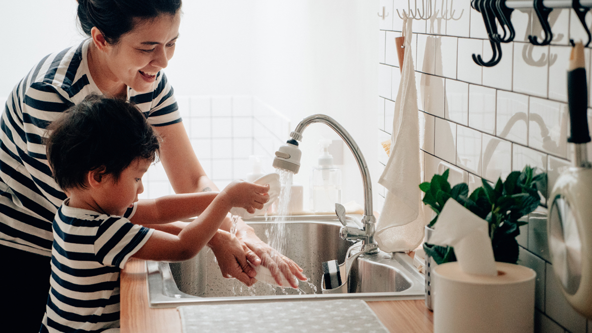 Mom uses natural cleaning products to help child wash hands