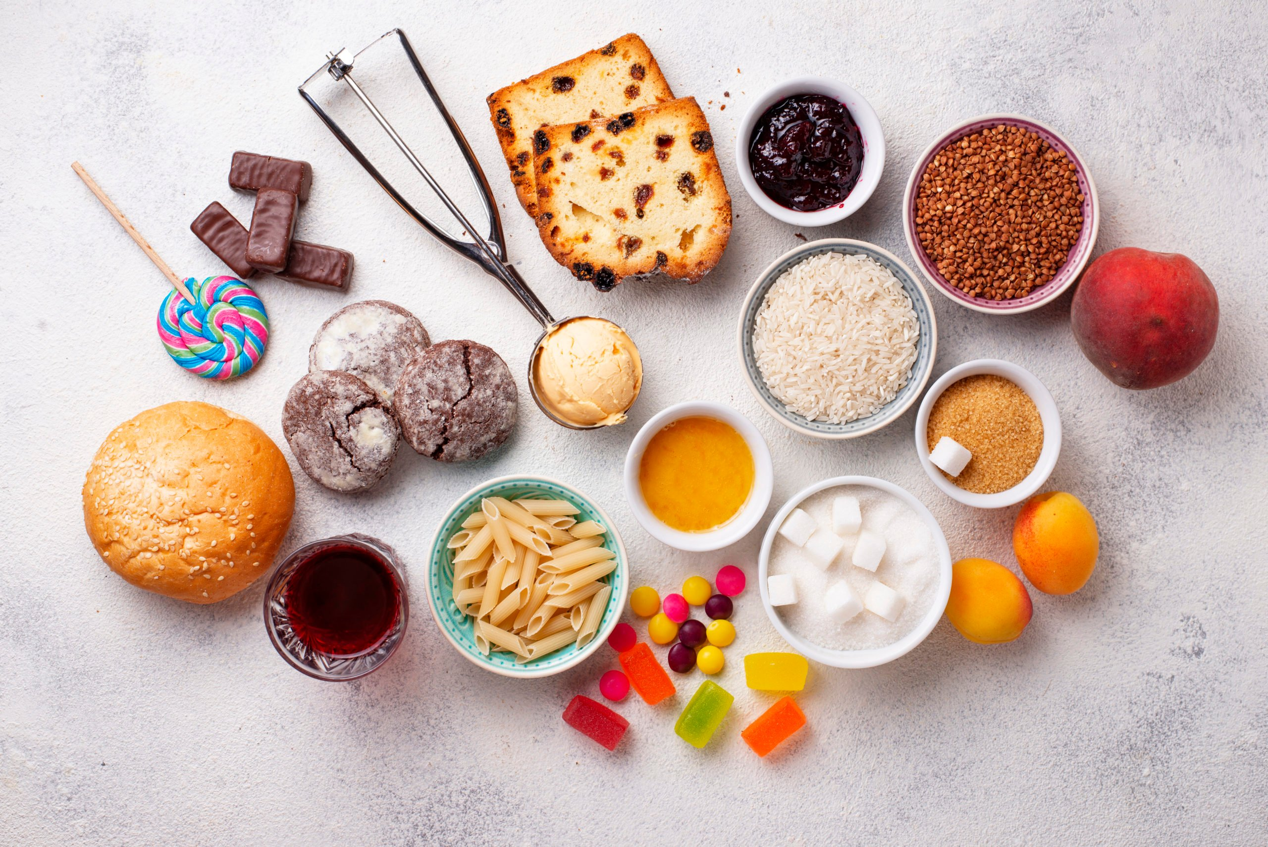 foods that cause inflammation shown on a table with breadsand candy